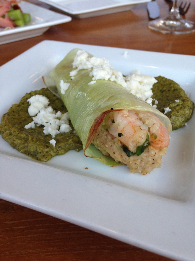 "Shrimp and grits in a leek ""tamale"" with roasted salsa verde and feta cheese"